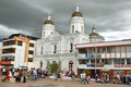 Bustle in the maketplace with the church behind latacunga ecuador april on april main square of ecuador Stock Photography