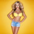 Busty beautiful blonde in denim shorts Stock Photos