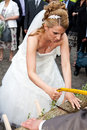 Busty bride sawing low with saw Royalty Free Stock Images