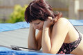 Busty woman with swimsuit reading news on tablet outdoor Stock Photography