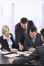 Busy business people working together talking on office meeting Royalty Free Stock Images