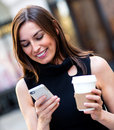 Busy business woman texting Royalty Free Stock Photo