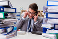 The busy businessman under stress due to excessive work