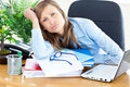 Busy businesswoman slumping onto her desk Stock Photo