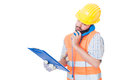 Busy contractor using phone while holding clipboard Royalty Free Stock Photo
