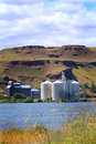 Busy grain elevators two large modern in eastern oregon on columbia river Stock Photos