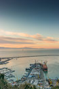 Busy harbor of salerno italy view the at sunrise with ships and containers on the dock Stock Images