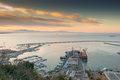 Busy harbor of salerno italy view the at sunrise with ships and containers on the dock Royalty Free Stock Photo