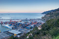 Busy harbor of salerno italy view the at sunrise with ships and containers on the dock Royalty Free Stock Image