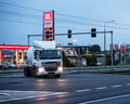 Busy intersection with driving truck by night in poznan poland Stock Image
