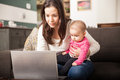 Busy mom working at home Royalty Free Stock Photo