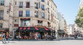 Busy Paris street scene in front of Le Cafe Conti Royalty Free Stock Photo