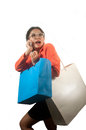Busy pretty young asian business woman with shopping bags and cellphone isolated on white background Stock Images