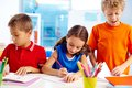 Busy pupils being with school work Royalty Free Stock Images