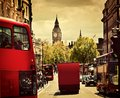 Busy street of london england the uk red buses big ben in background Stock Image