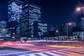 Busy streets of Osaka at night time with light trails Royalty Free Stock Photo