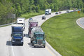 Busy traffic on an interstate highway heavy car and truck the Royalty Free Stock Photography