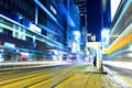 Busy traffic with tram stop in Hong Kong city Royalty Free Stock Photo