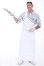 Butcher holding knife Royalty Free Stock Photo