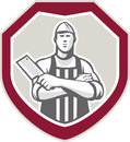 Butcher with meat cleaver shield retro illustration of a cutter worker knife facing front set inside crest on isolated background Stock Images