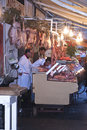 Butcher sells meat on the local market in palermo december called ballaro this is also tourist attraction Royalty Free Stock Photo