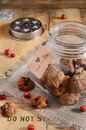 Butter biscuits with dried cranberry chocolate in glass jar on linen napkin Royalty Free Stock Images