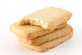 Butter biscuits in a stack on white surface Royalty Free Stock Photos
