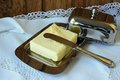 Butter in the butter dishand and knife on a white tablecloth Stock Photo