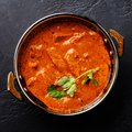 Butter chicken spicy curry meat food in Kadai dish Royalty Free Stock Photo