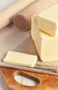 Butter and kitchen utensil piece of on paper knife Royalty Free Stock Photo