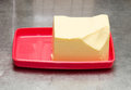 Butter on plate big clump of a red Royalty Free Stock Photo