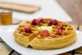 butter waffle with honey and strawberry