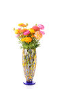 Buttercups bouquet of bright multicolor in vase over white Royalty Free Stock Images