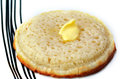 Buttered English crumpet close up Royalty Free Stock Photo