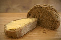 Buttered rye bread in natural light Royalty Free Stock Photos