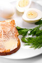 Buttered toast and two boiled eggs Stock Image