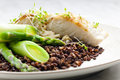 Butterfish with green lentils Royalty Free Stock Image