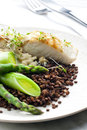 Butterfish with green lentils Stock Photography