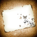 Butterflies at paper over grunge background Royalty Free Stock Image