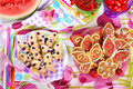Butterfly shaped gingerbread and puff pastry cookies with bluebe blueberry for children s birthday party Stock Images