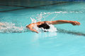 Butterfly stroke in the swimming pool Royalty Free Stock Image