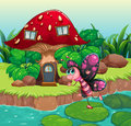 A butterfly waving near the red mushroom house illustration of Royalty Free Stock Image