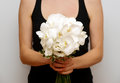 Butterfly white orchid wedding bouquet hold by girl in black dress Royalty Free Stock Photos