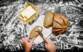 The buttering of bread with butter on Board with flour. Royalty Free Stock Photo