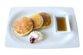 Buttermilk pancakes with maple syrup and weep cream in plate on white background thailand Royalty Free Stock Photos