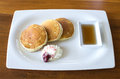 Buttermilk pancakes with maple syrup and weep cream in plate on the wood table thailand Stock Photos