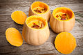 Butternut squashes with pumpkin cream of squash and potatoes soup decorated bacon and chives Stock Image