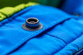 Button clasp close up of on blue coat Stock Images
