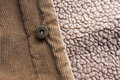 Button close up view of a jacket made of corduroy focused on a Royalty Free Stock Photo