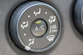 Button to adjust the level of air conditioning in car Royalty Free Stock Images